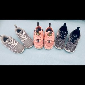 3 pairs of girl's toddler sized 7 Nike sneakers.
